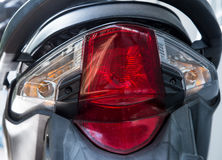 Red rear light of the modern motorcycle. Stock Photos
