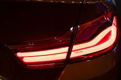 Red Rear light on a modern red car with reflection. The Closeup. Back Red Tail light car Stock Photo
