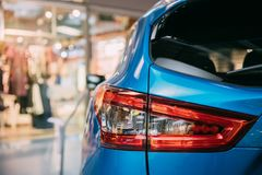 Red Rear Lights Of Blue Color Compact Crossover SUV Car Royalty Free Stock Images