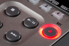 Red record button illuminated on recorder Stock Photos