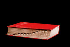 Red Reference Book. Closeup of a red hard bound book lying flat shot from the side Royalty Free Stock Images