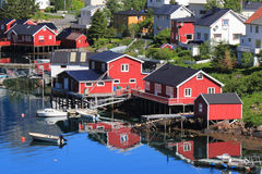 Red reflections of Reine in Lofoten Royalty Free Stock Image