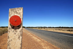 Red reflector at the Eyre Highway. In South Australia Royalty Free Stock Photo