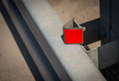 Red reflector on road. Royalty Free Stock Image