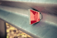 Red reflector on road. Royalty Free Stock Photo