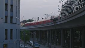 Red Regional Train Arriving. Berlin Central Railway Station. Red Regional Train Arriving. People Walking On The Street, Traffic. Summer Day At Sunset stock footage