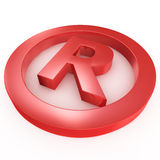 Red registered trademark sign laying on a white gr Stock Images
