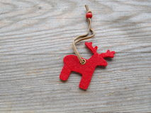 Red reindeer. On wooden board Stock Image