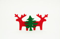 Red reindeer and green christmas tree Royalty Free Stock Photos