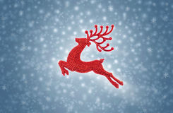 Red reindeer moose jumping on snow background Stock Image