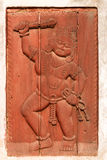 Red relief of man with club and rope (Bhaktapur, Nepal) Royalty Free Stock Photo
