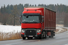 Red Renault Trucks T Semi Hauls Cargo in Winter Royalty Free Stock Images