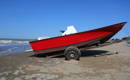 Red rescue boat for the lifeguard in summer Royalty Free Stock Image