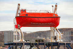 Red rescue boat Stock Images