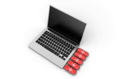 Red Rescue Drive Connected To Silver Laptop Royalty Free Stock Photography