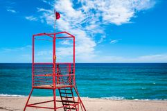 Red rescue tower on the beach. Sky, water, ocean, sea, sand, lifeguard, blue, landscape, outdoor, nature, beautiful, vacation, coast, surf, summer, safety royalty free stock photos
