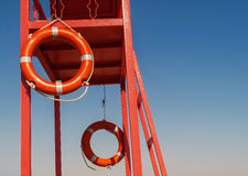 Red rescue tower with a lifeline against the blue sky Royalty Free Stock Image