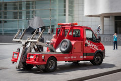 Red rescue wrecker car at street of Barcelona town, Spain. Stock Photos