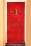 Red residential door. Retro wooden red residential house entrance door Royalty Free Stock Image