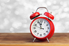 Red retro alarm clock on white bokeh abstract background Stock Images