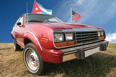 Red Retro Car. Vintage Red Retro Car on Background Blue Sky with Flag Cuba and USA Stock Images