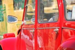 Red retro car. Close up of a shiny red retro car Royalty Free Stock Images