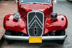 Red retro car in Laos. Royalty Free Stock Photos