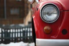 Red Retro Car village spring season. Red Retro Car lights village spring season Stock Photo