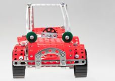 Red retro car from metal construction set. On grey background Royalty Free Stock Image