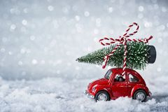 Red retro car. With a christmas tree royalty free stock photo