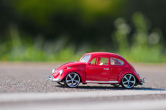 Red retro car. Standing on the road Royalty Free Stock Photos