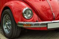 Red retro car stands outdoors royalty free stock photo