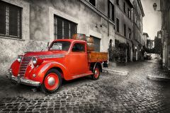 Red retro car. On the street of Trastevere in Rome, Italy Stock Image