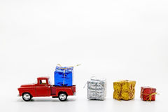 Red retro car toy strewed boxes with gifts isolated Royalty Free Stock Image