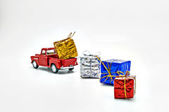 red retro car toy strewed boxes with gifts isolated Stock Image