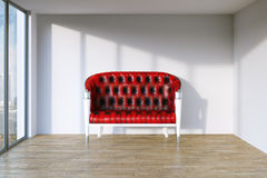 Red retro leather sofa in modern interior room with panoramic wi Royalty Free Stock Image