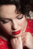 Red retro make-up. Close-up portrait of a red retro make-up royalty free stock photo