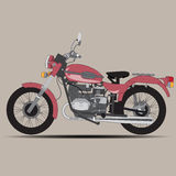 The red retro motorcycle Stock Images