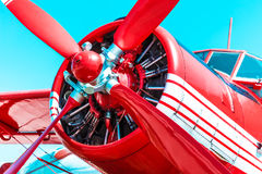 Red retro propeller engine airplane Royalty Free Stock Image
