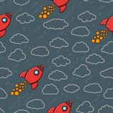 Red retro rockets icon with clouds on a grey blue cosmos backgro Royalty Free Stock Photos