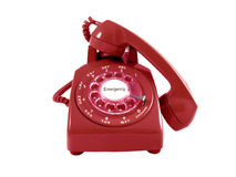 A red retro rotary phone. Isolated on white.  Emergency text in the center of the dial Royalty Free Stock Photography