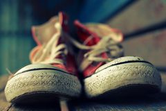Red retro sneakers. On the street royalty free stock photos