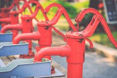 Red retro style hand water pump Stock Photography