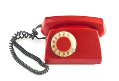 Vintage red phone isolated on a white background. Royalty Free Stock Image