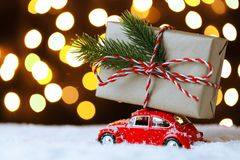 Red retro toy car delivering Christmas or New Year gifts. On festive background stock photos