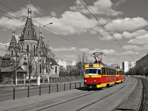 Red retro tram on the street Stock Photos
