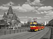 Red retro tram on the street Stock Photos