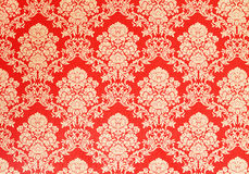 Red retro wallpaper with golden floral texture, victorian design Stock Photography