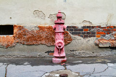 Red retro water pump Royalty Free Stock Images