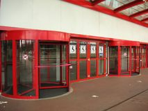 Red revolving doors. With handicap sign Royalty Free Stock Photo